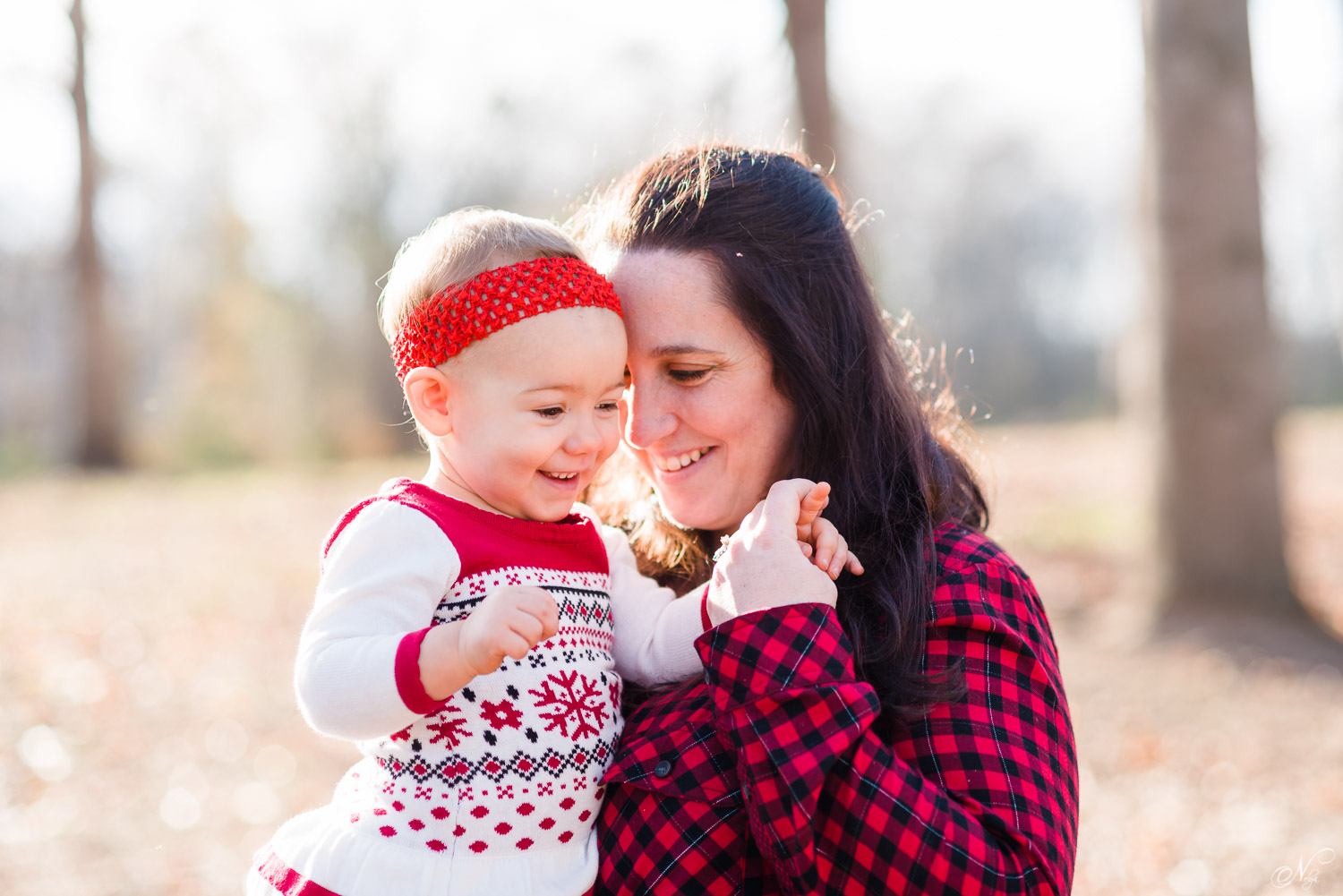 mother and toddler daughter dressed in Christmas red annd white outfits
