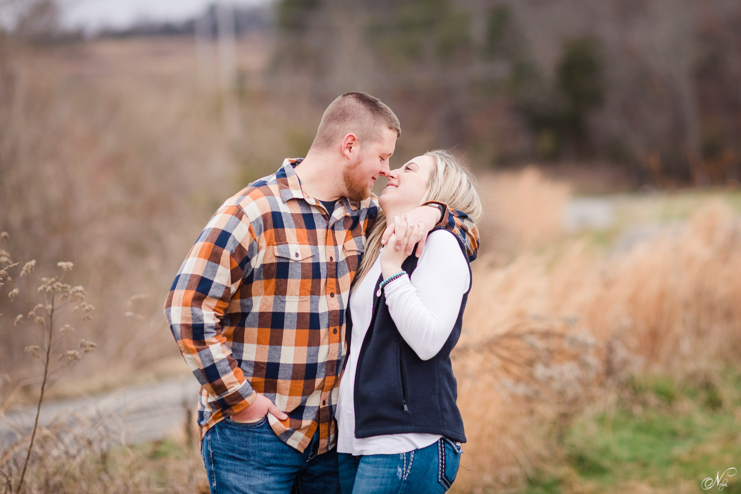 couple wearing plaids and solids with jeans for engagement session