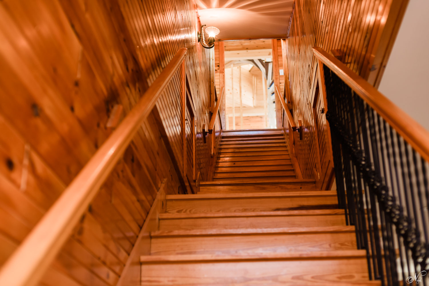 The all wood stairwell to get to the third floor at The Views at Sunset Ridge