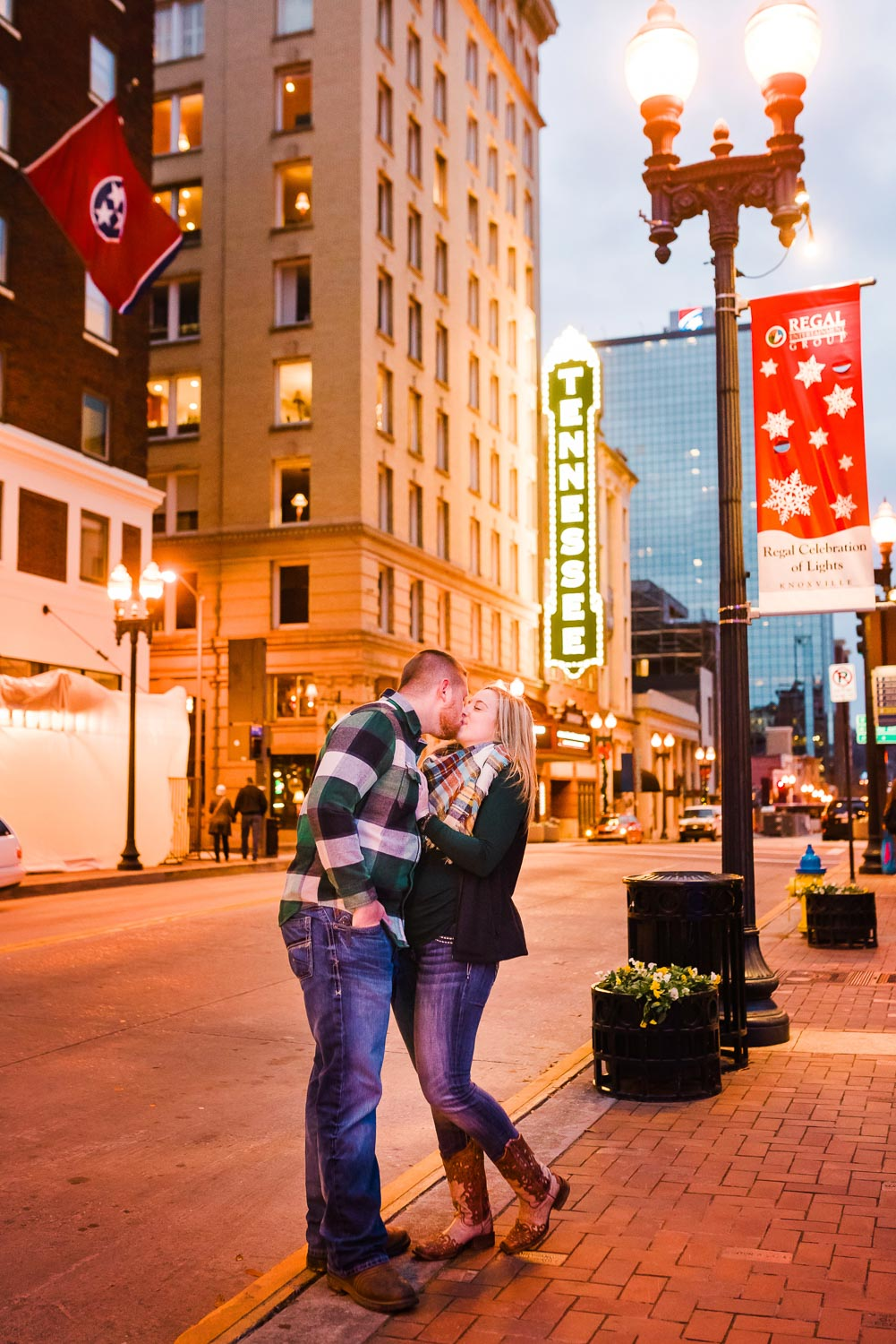 Christmas kiss on Gay St under the Tennessee Theater sign in Knoxville