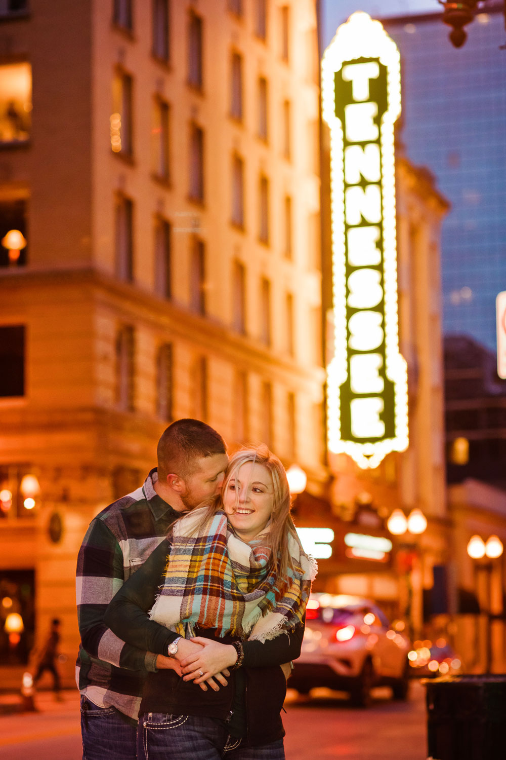 guy and girl in a happy hug on Gay ST in front of the Tennessee Theater sign