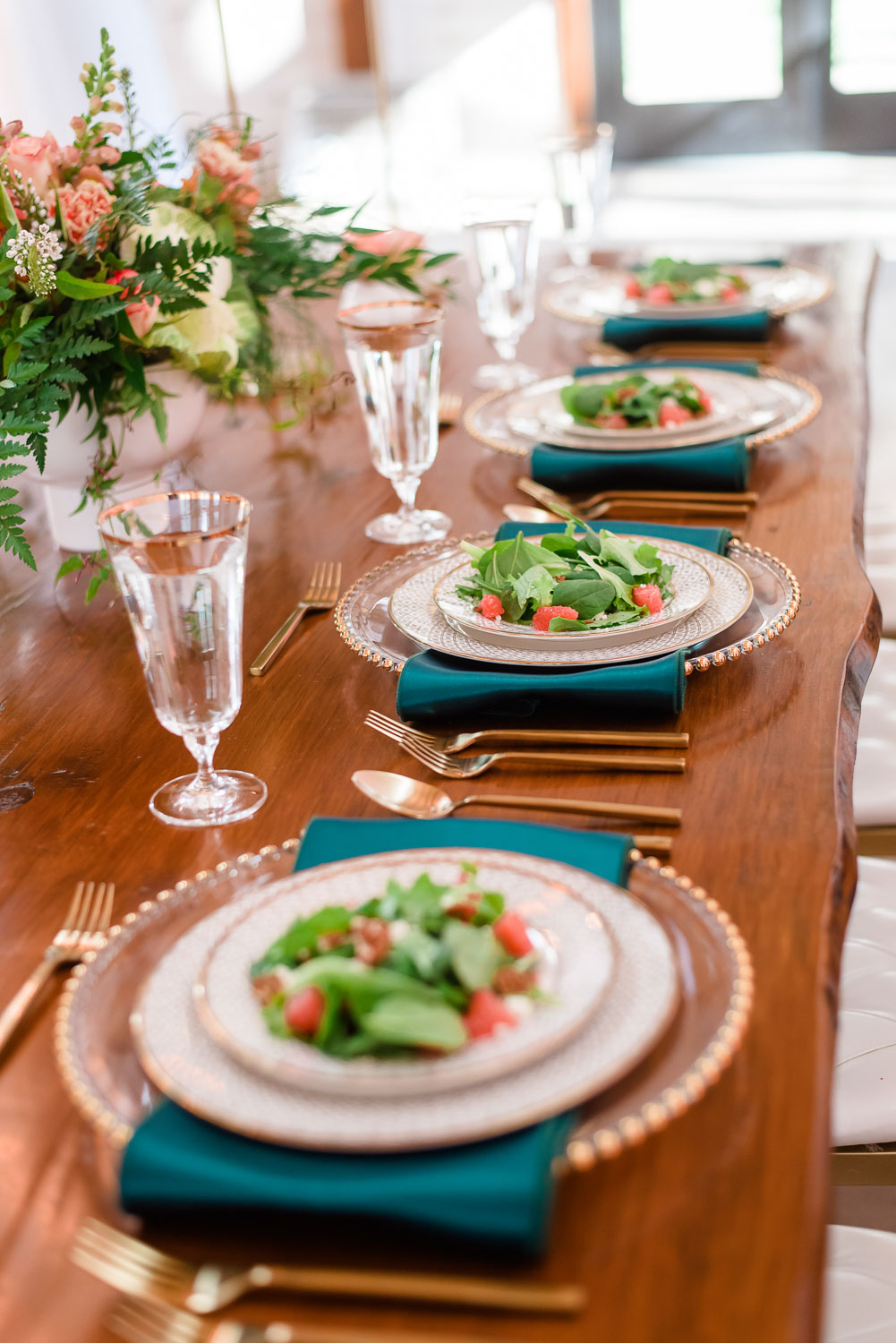fresh baby spinach salad on plates from Chattanooga Tent on wooden farm table