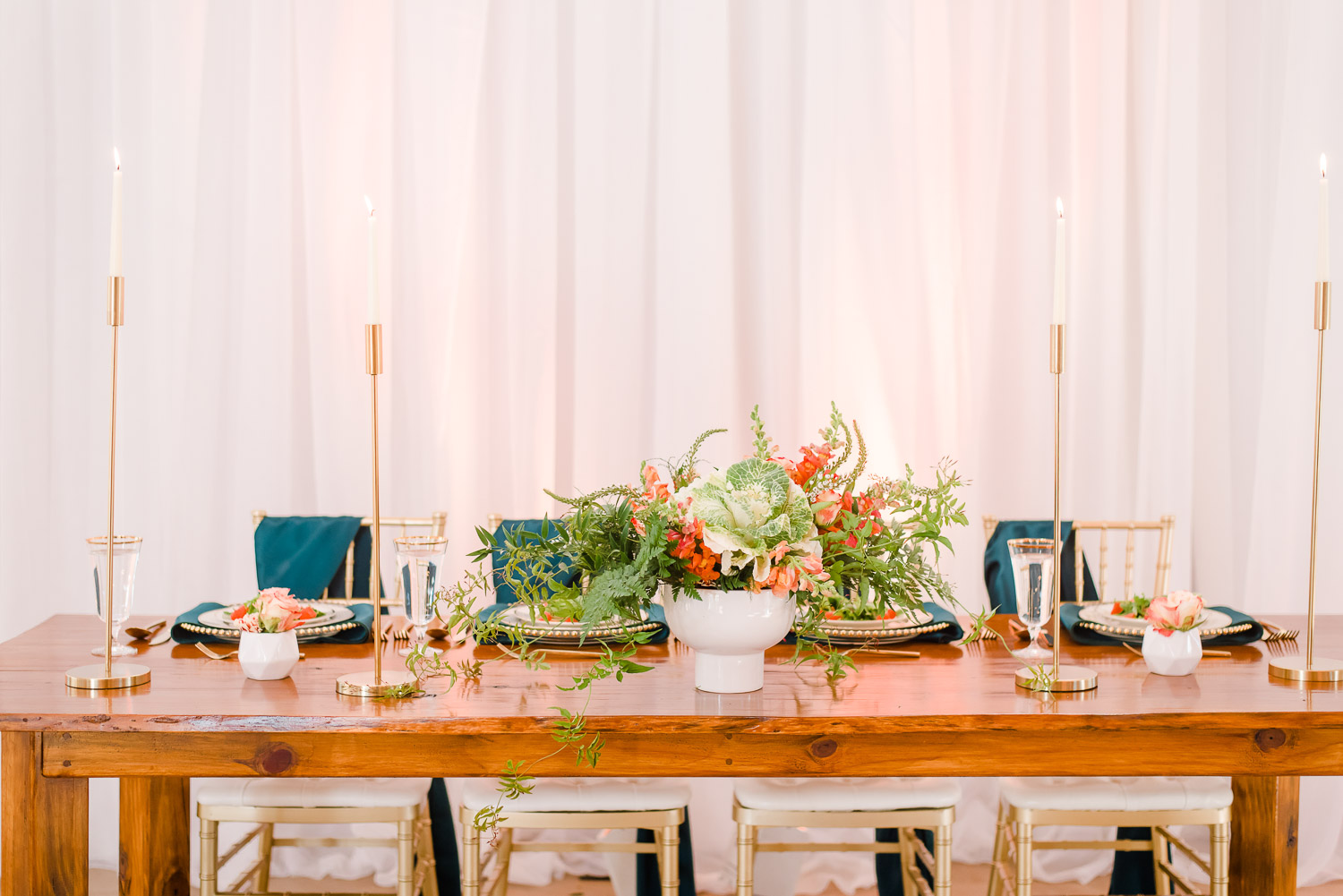 close up of head table with tall gold candle sticks and green napkins at Hiwassee river weddings