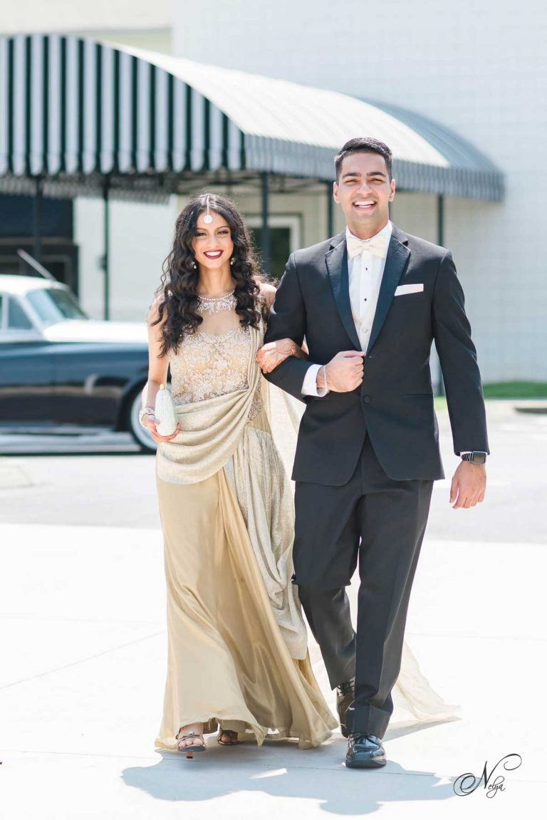 gril in gold dress and guy wearing blck suit for engagement party in Knoxville TN