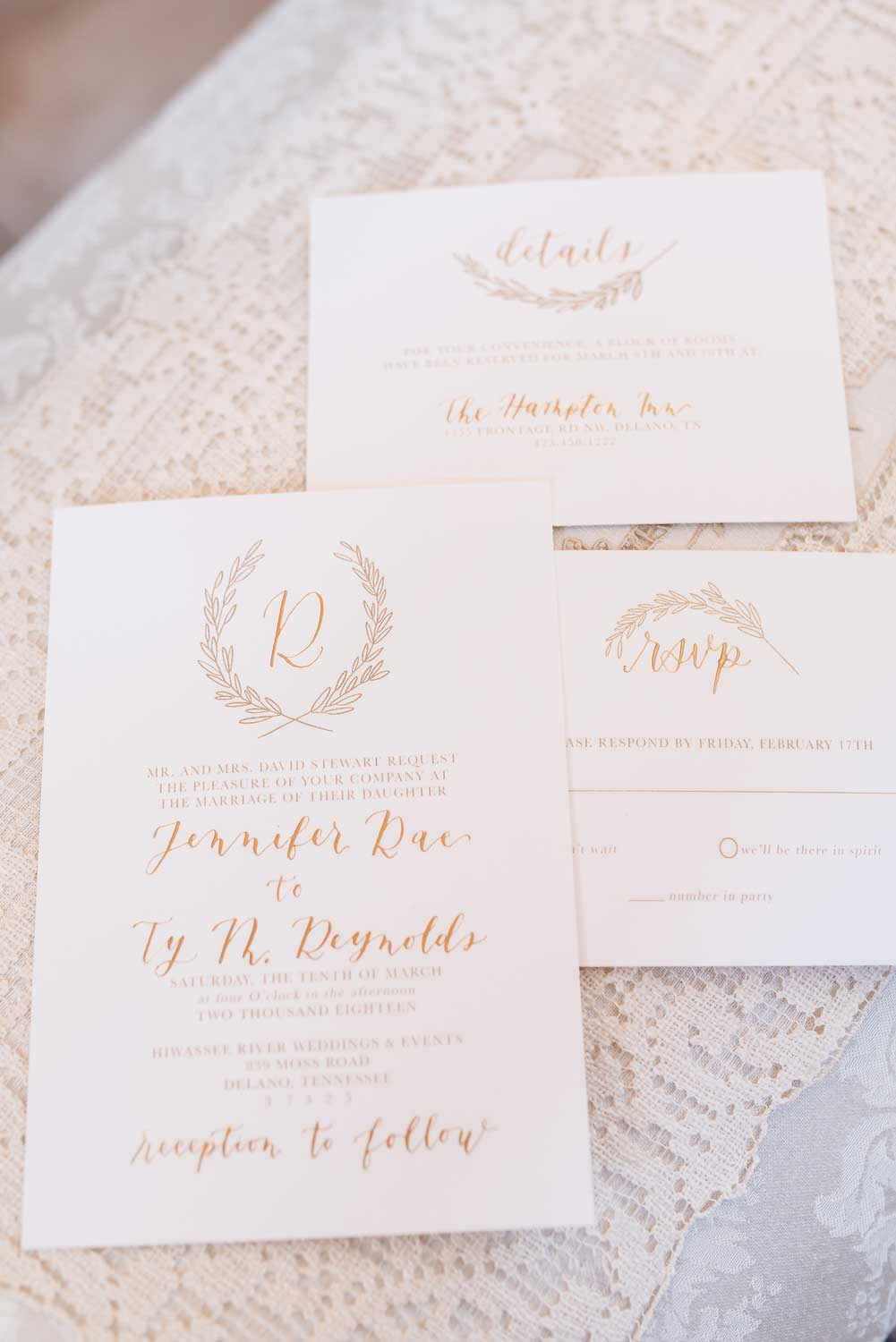 wedding Invitations in gold and white on vintage lace