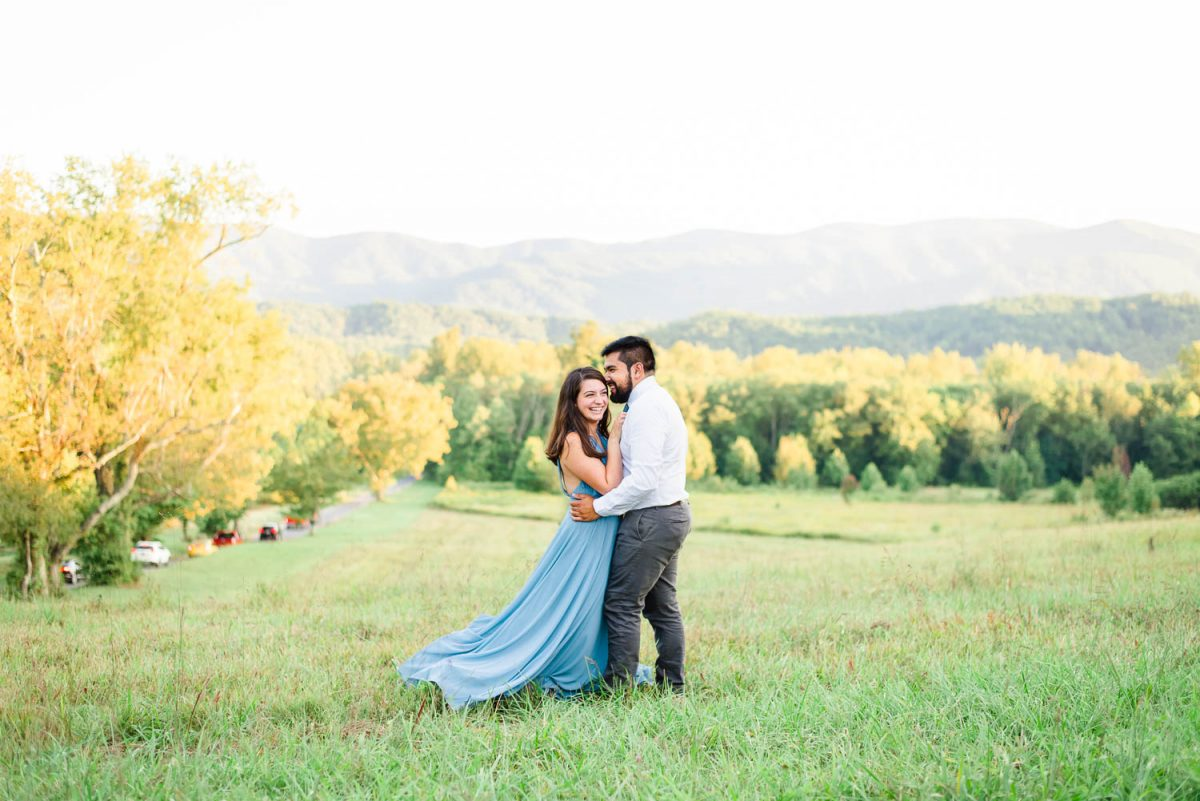 two people outside in front of mountains and fall foliage in TN
