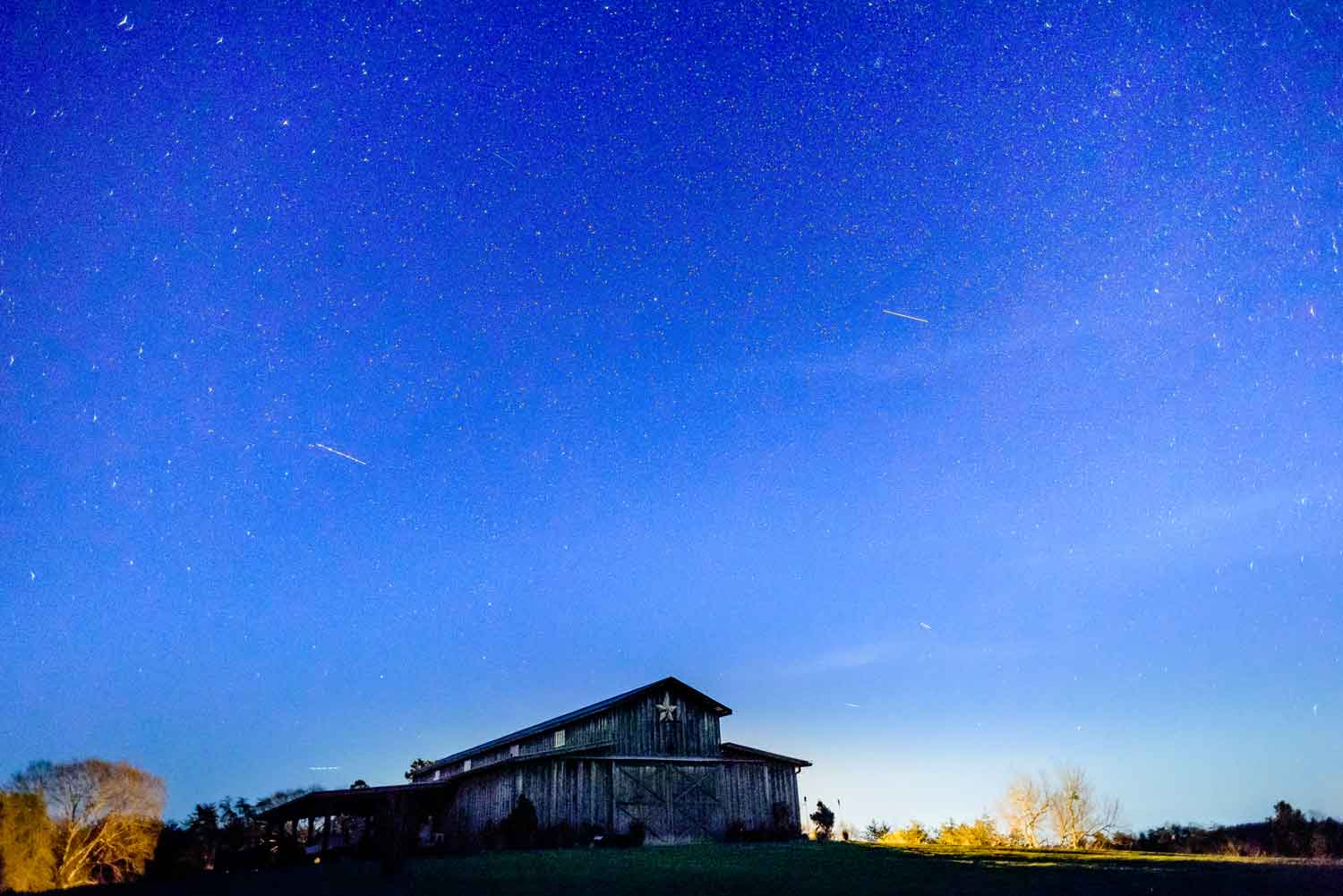 The barn at Drewia Hill at night under starry sky.