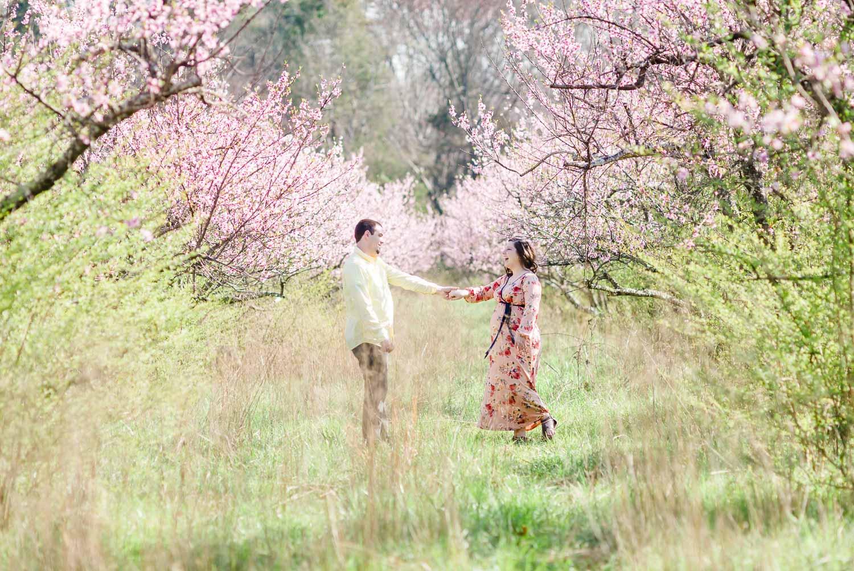 couple dancing in the peach orchard behind barn wedding venue near chattanooga TN