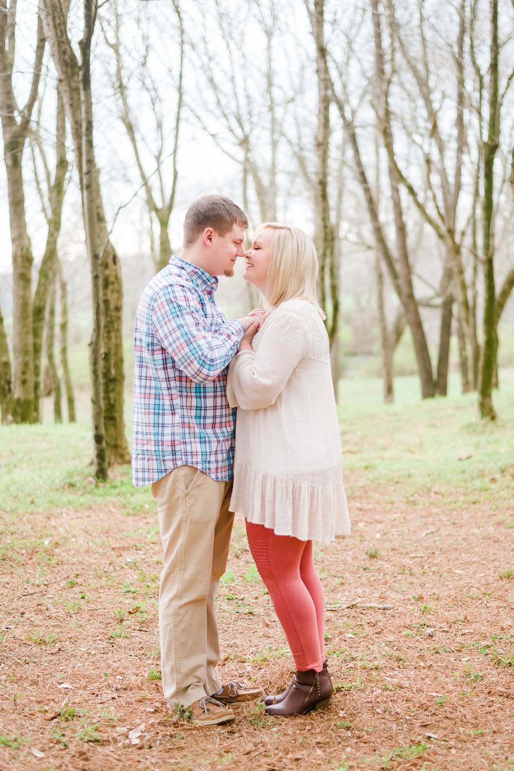 couple near river near the new forest ceremony site at hiwassee river weddings