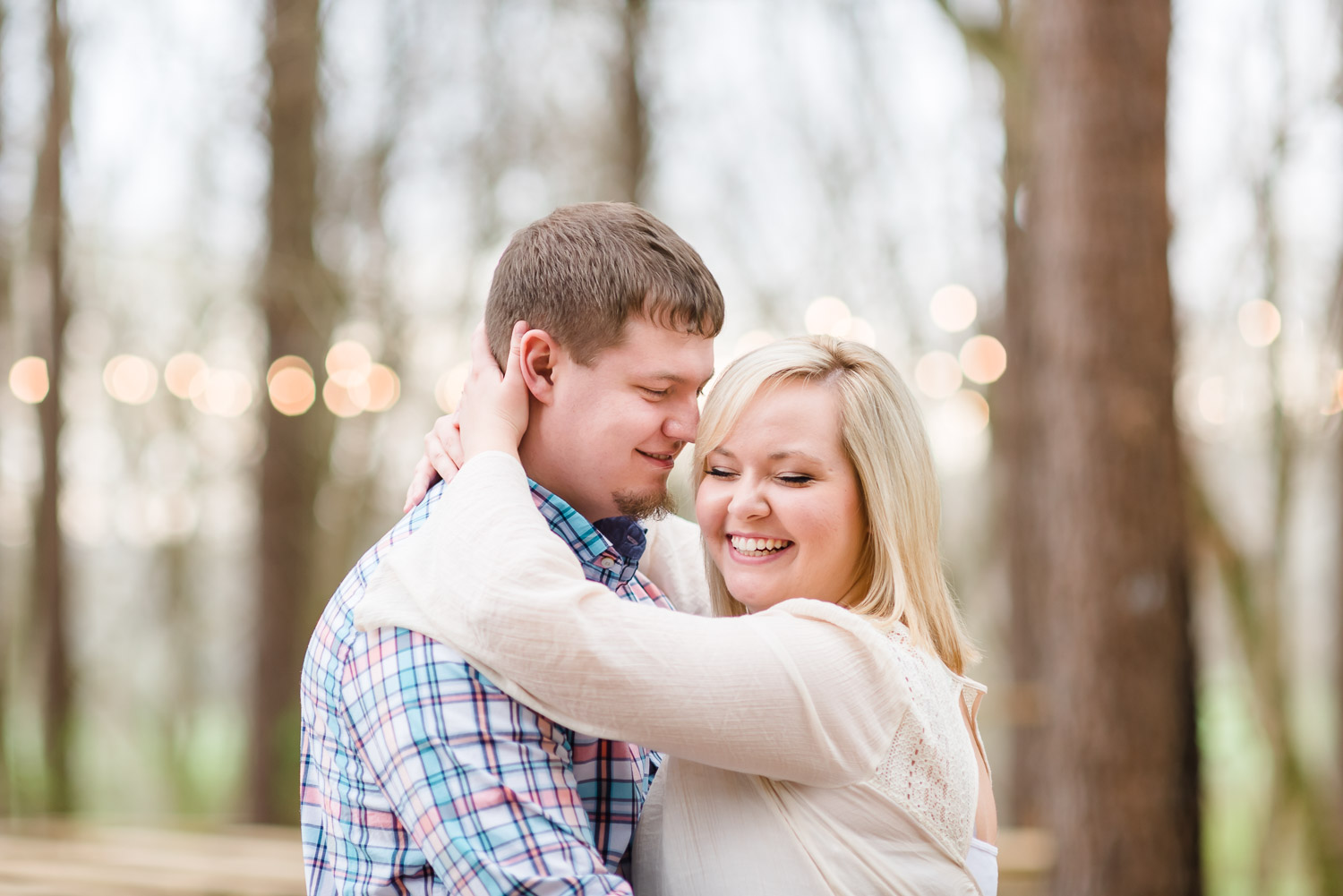 smiling couple in cream colored and plaid shirt