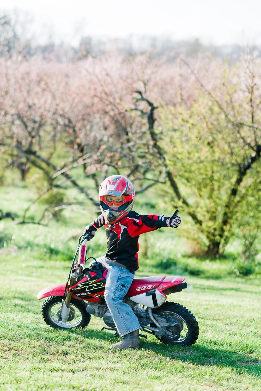 little Honda dirt bike rider showing me the peach orchard at the Barn at Drewia Hill in Sale Creek TN