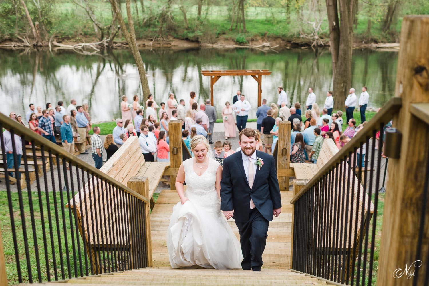 newly married couple walking up stairs at Hiwassee River Weddings venue