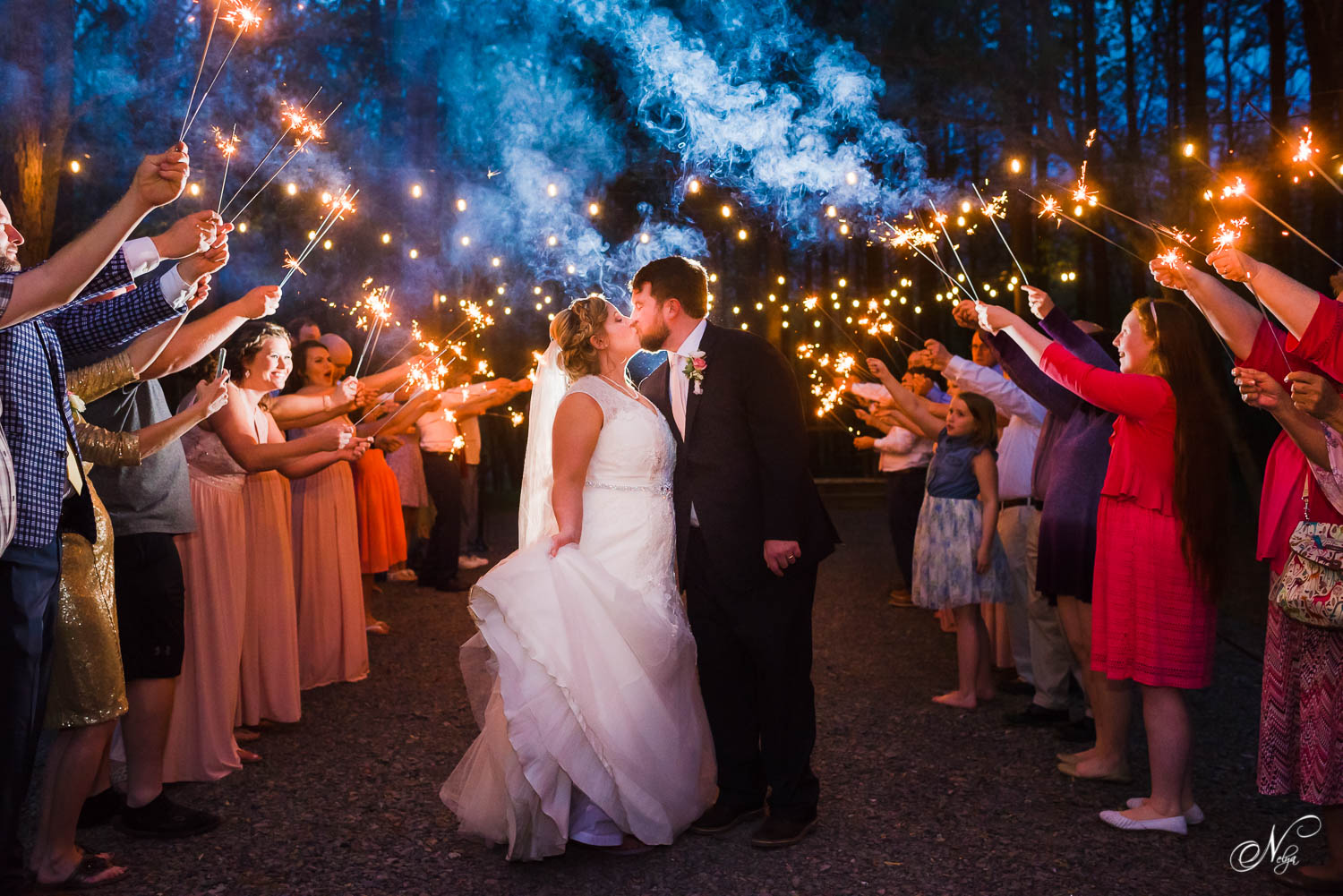 wedding sparkler exit with long sparklers at the Forest Ceremony site at Hiwassee River weddings in Delano TN