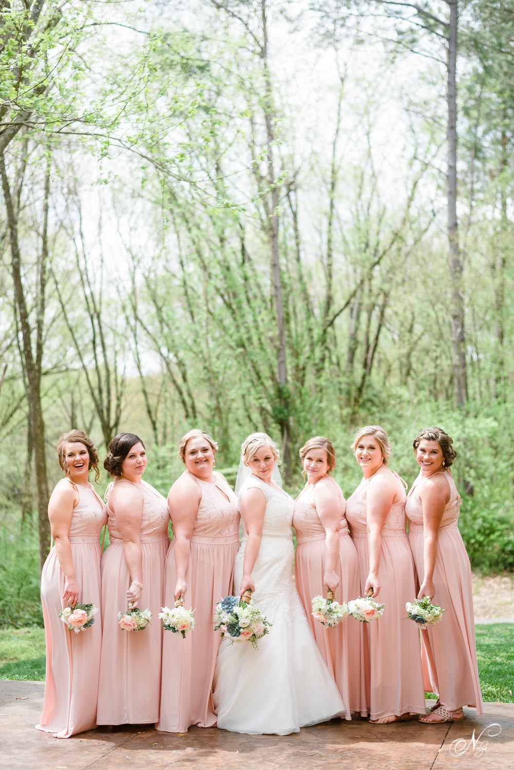 bride and her girls in blush dresses before the wedding ceremony