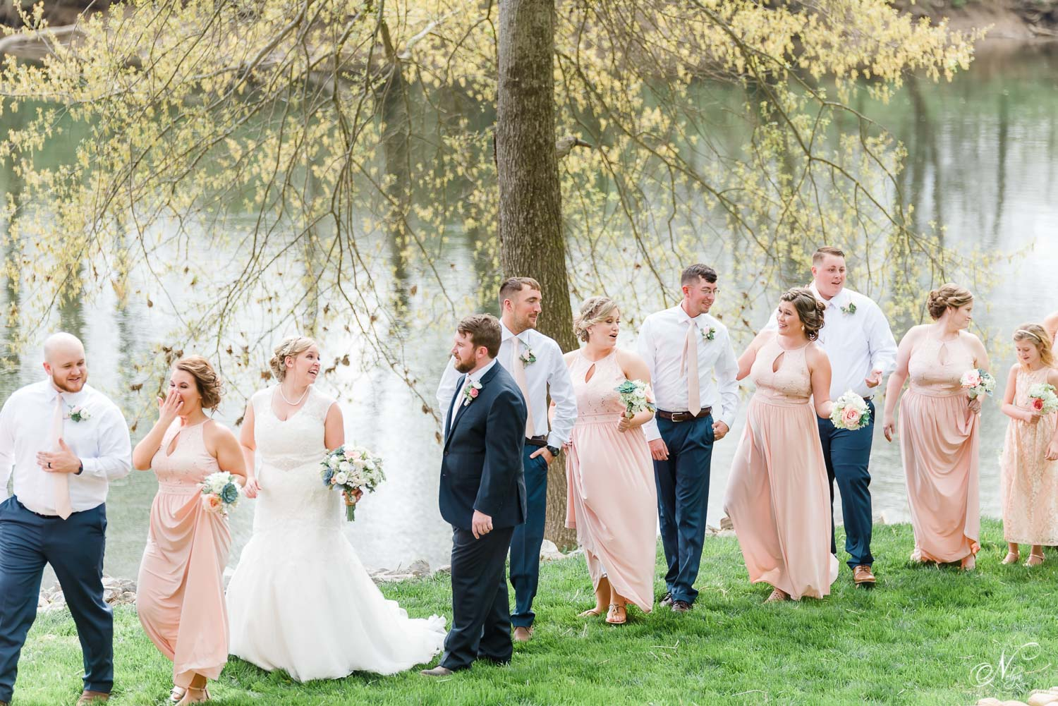 people outside at a Southern wedding along the Hiwassee river on a warm april day