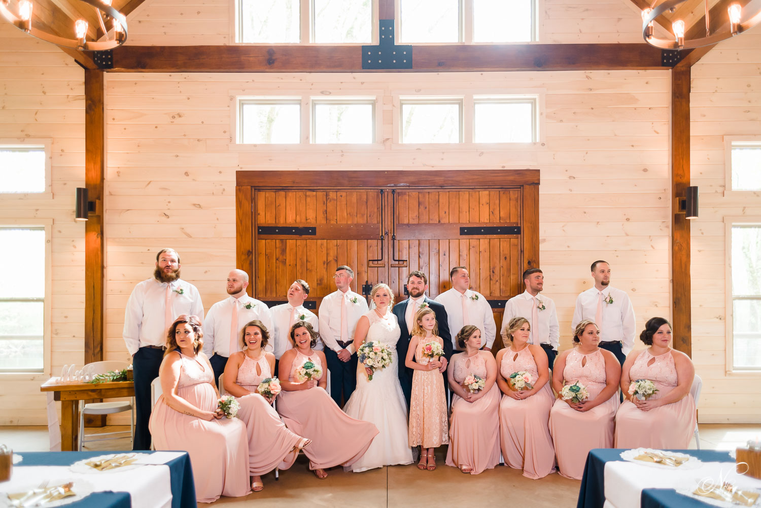 bridal party inside in front of big oak wooden doors at Hiwassee river weddings.