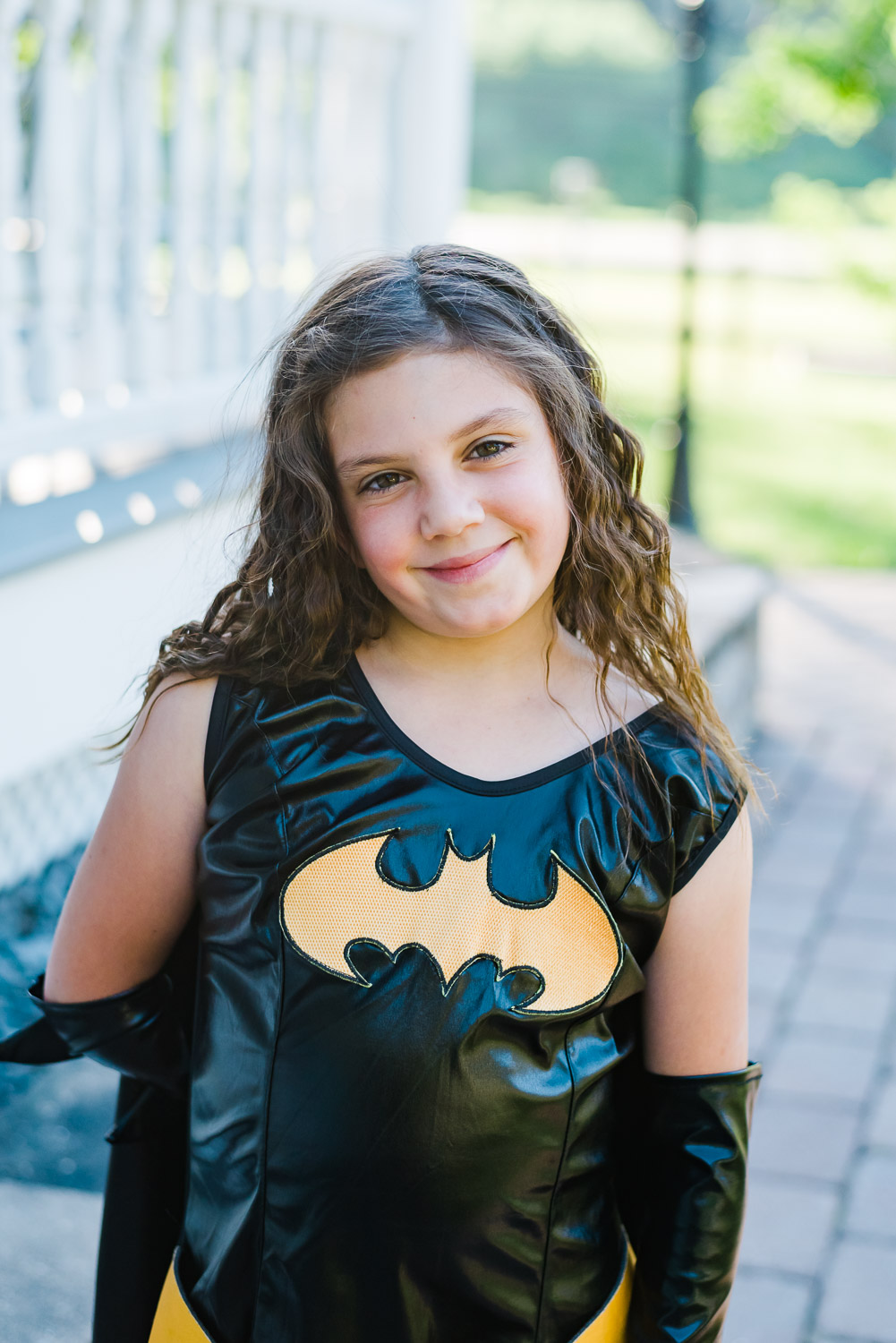girl in bat girl costume smiling at the camera