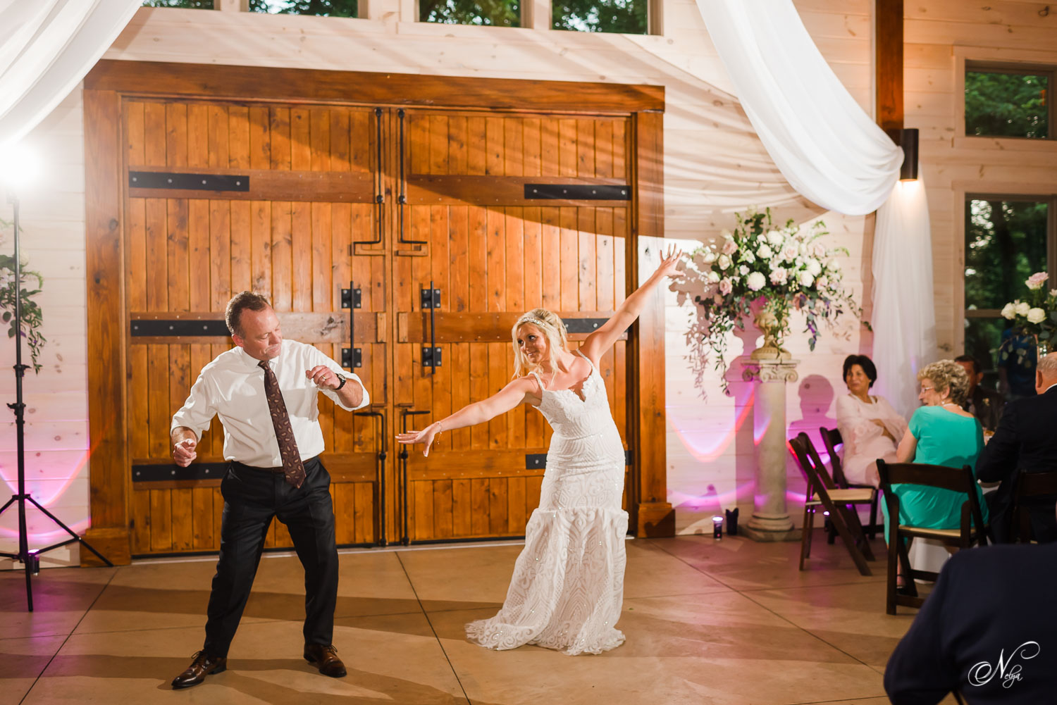 bride and her dad dancing a special dance at her wedding reception