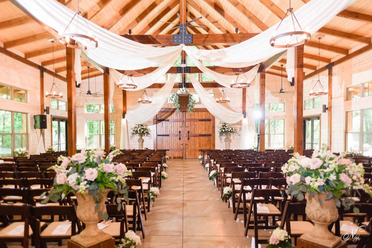 indoor wedding ceremony withchairs from Bradley Rental of Cleveland TN at Hiwassee River weddings