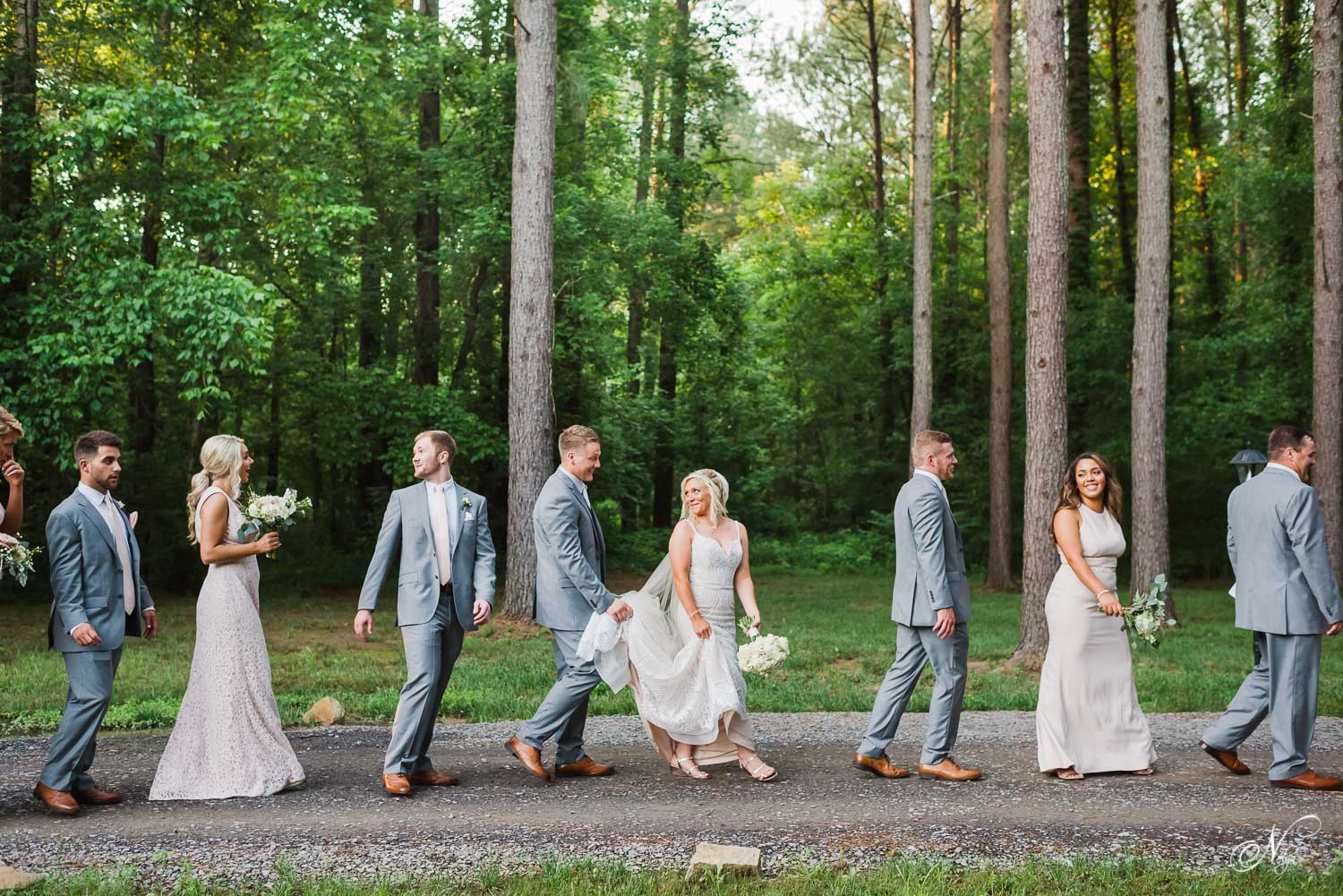 12 person wedding party walking through woods in Tennessee