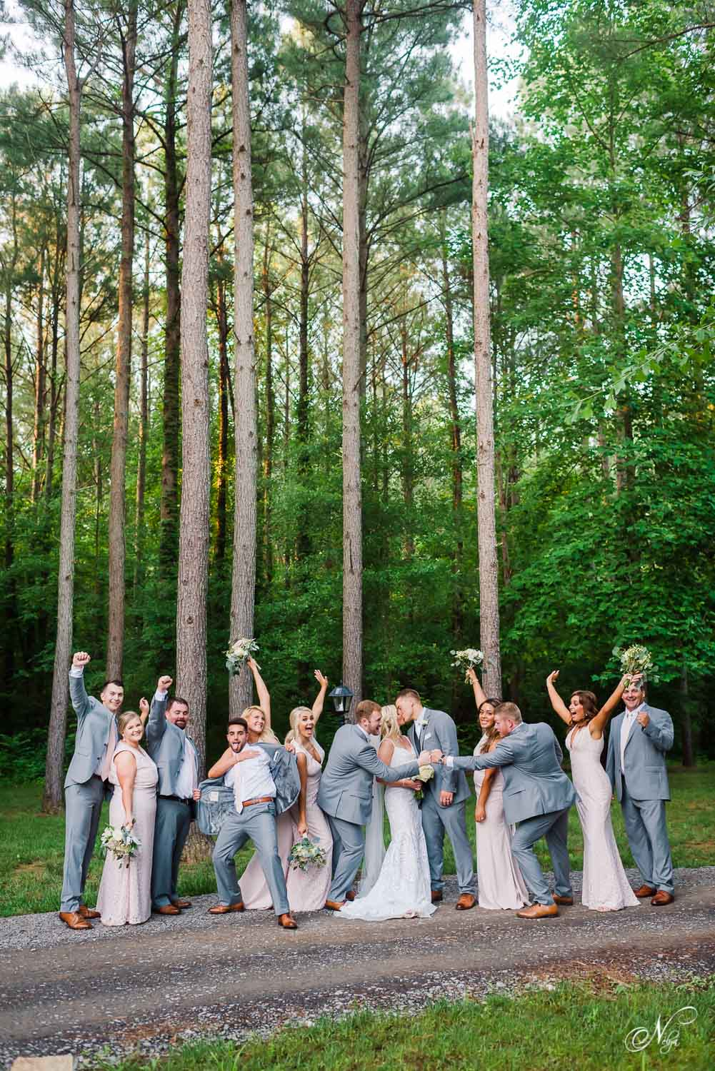 fun wedding party pose with 13 people