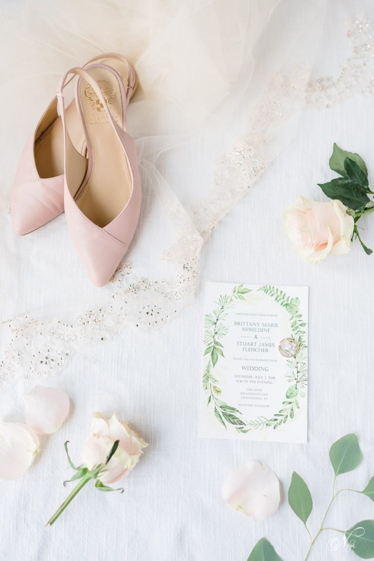 pink leather Vince Camuto wedding shoes, pink roses, wedding invitation and wedding bands all styled together in Chattanooga TN