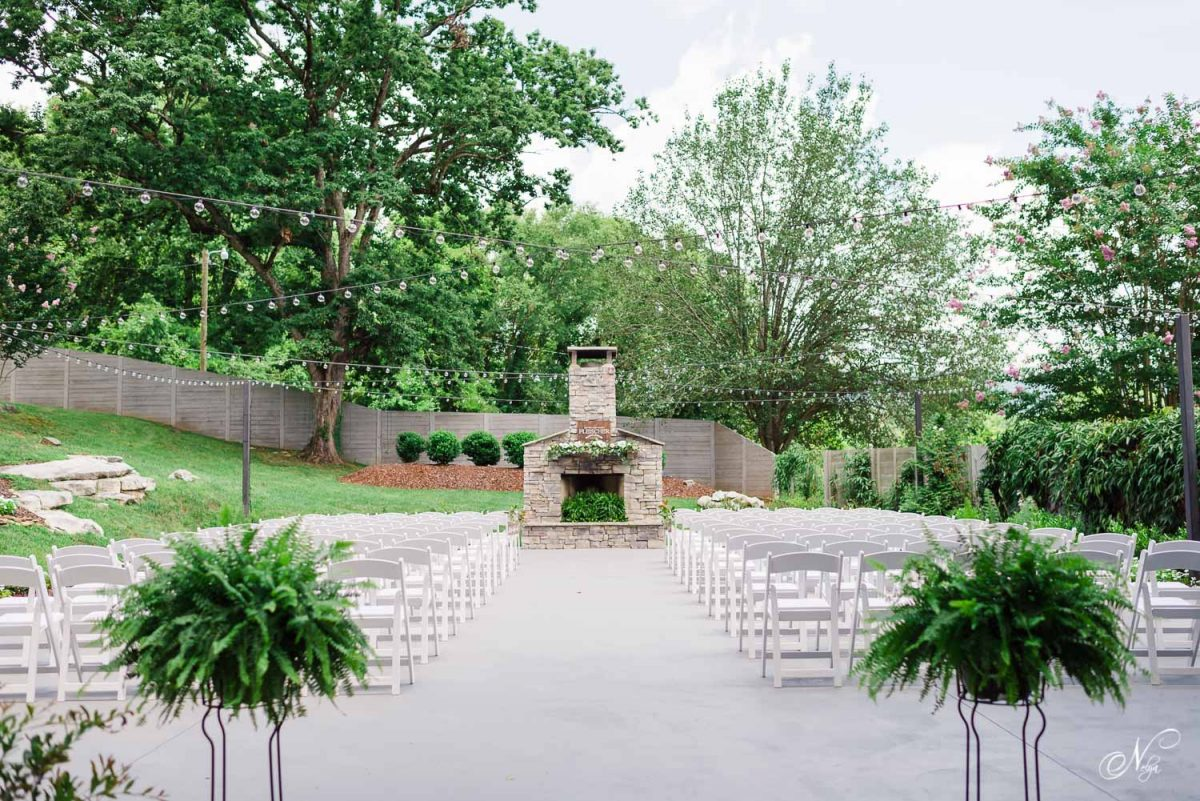 THE Garden ceremony area and outdoor stone fireplace at The Venue Chattanooga