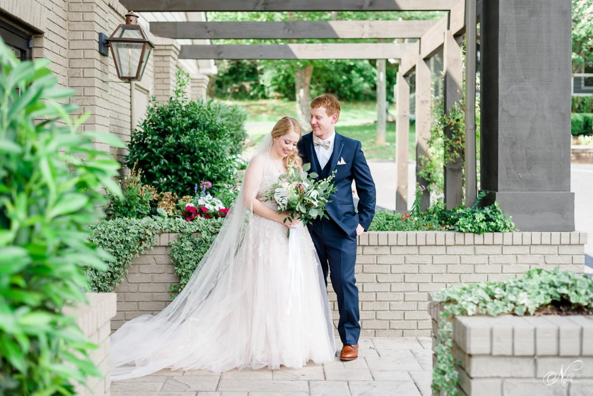 bride and groom outside under front trellis at The Venue Chattanooga in July