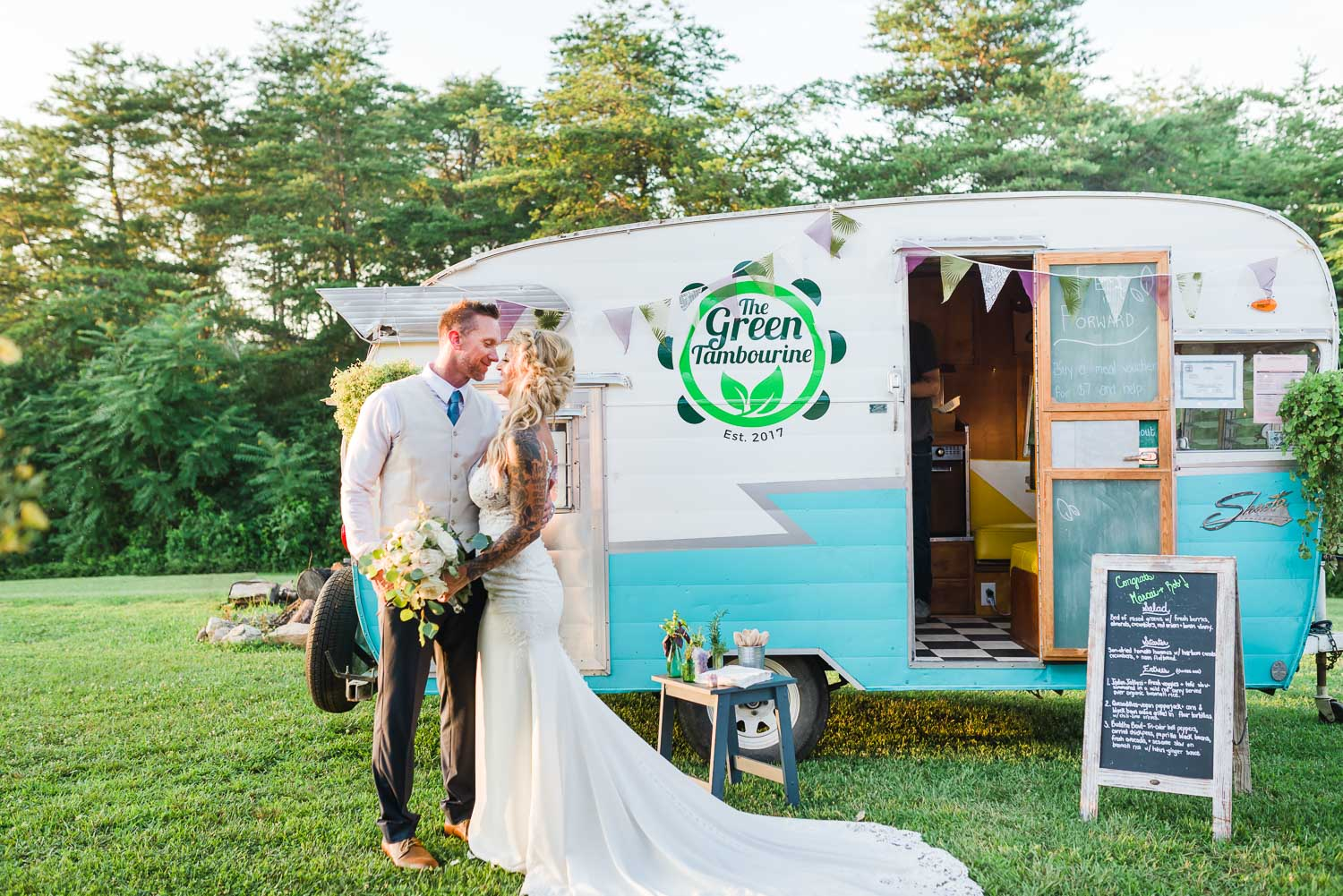 bride and groom in front of The Green Tambourine vegan food truck or food camper in Tennessee