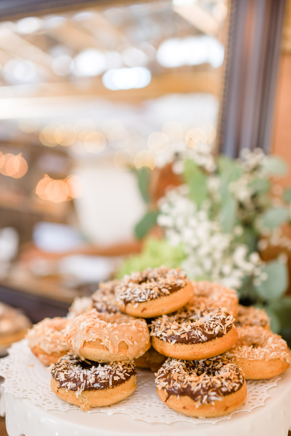 vegan donuts from Cashew Chattanooga as wedding cake. And boy feeding bride a donut