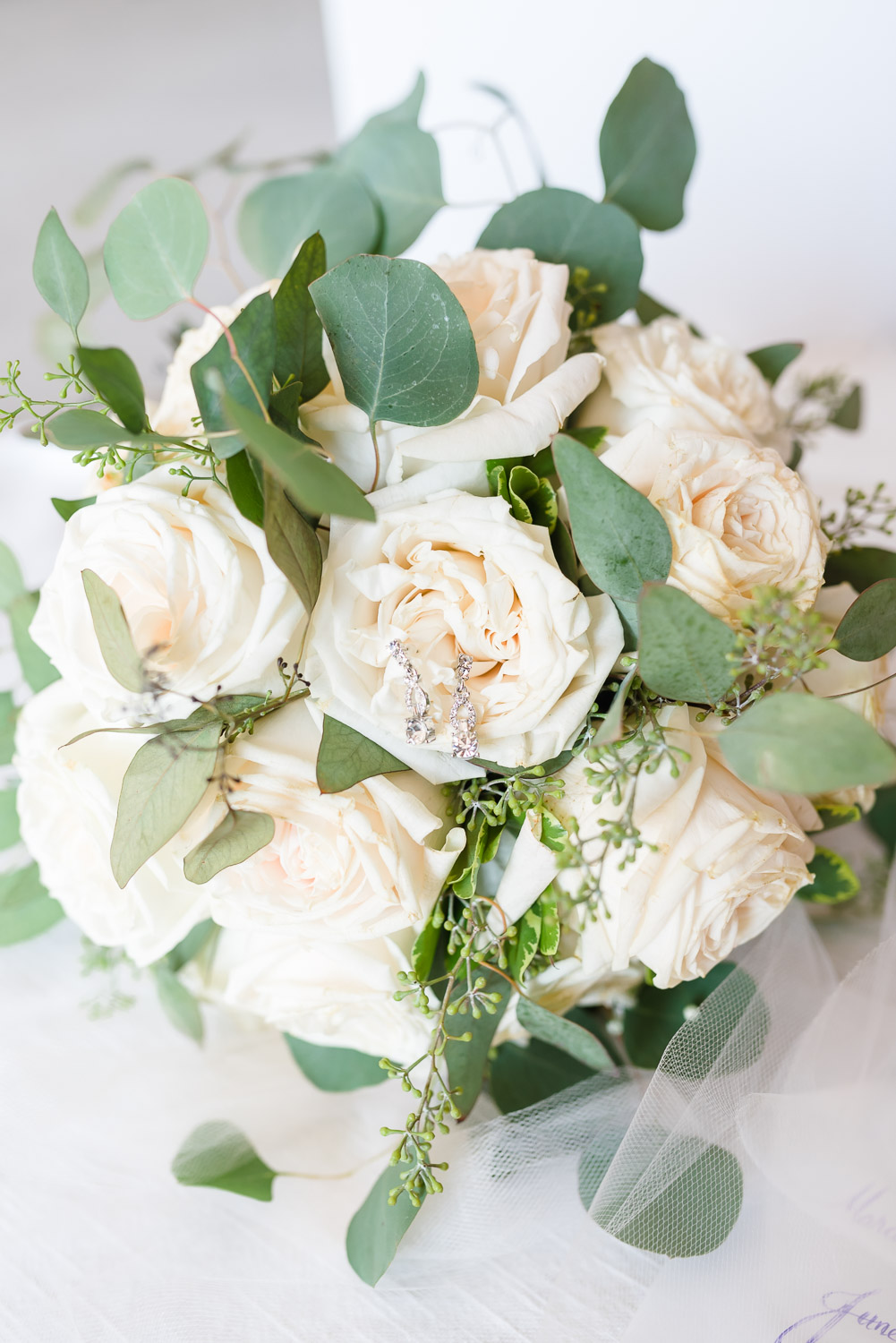 white rose and eucaliptus wedding bouquet made by staff at The Barn at Drewia Hill in Sale creek TN
