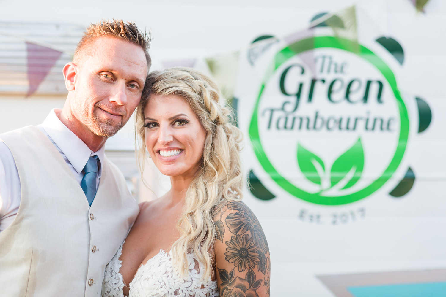 newlyweds in front of the Green Tambourine food truck from Chattanooga TN