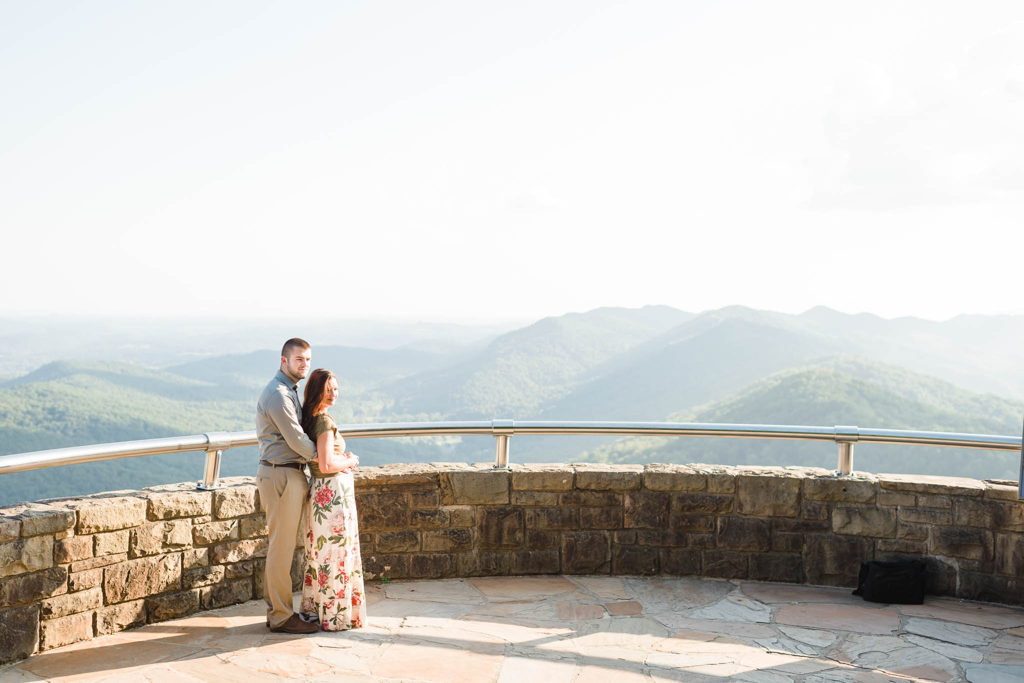 two soon to be married people enjoying the beautiful view from The Pinnacle overlook at Cumberland Gap TN