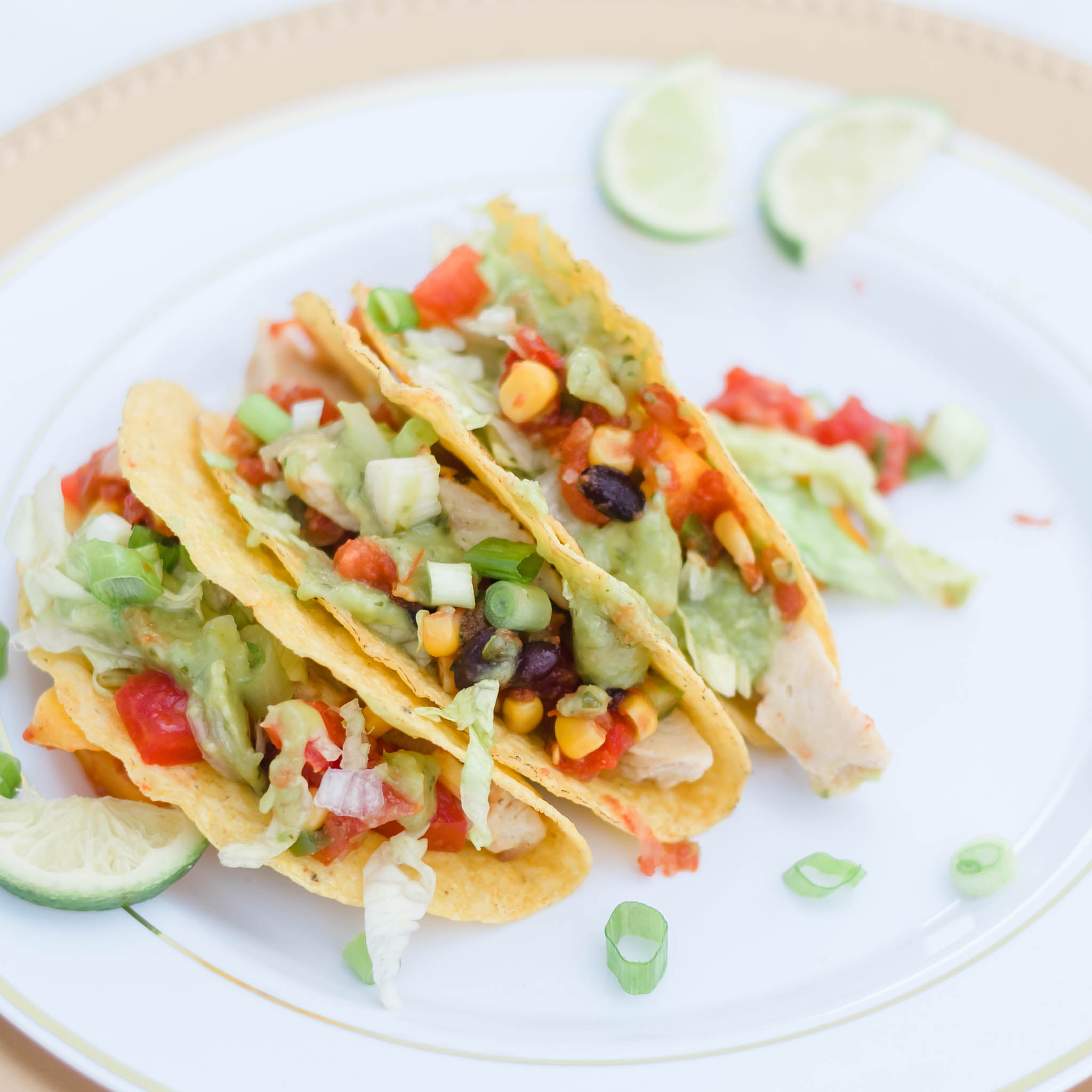 Gluten free Chicken Tacos with tomatoes and lime