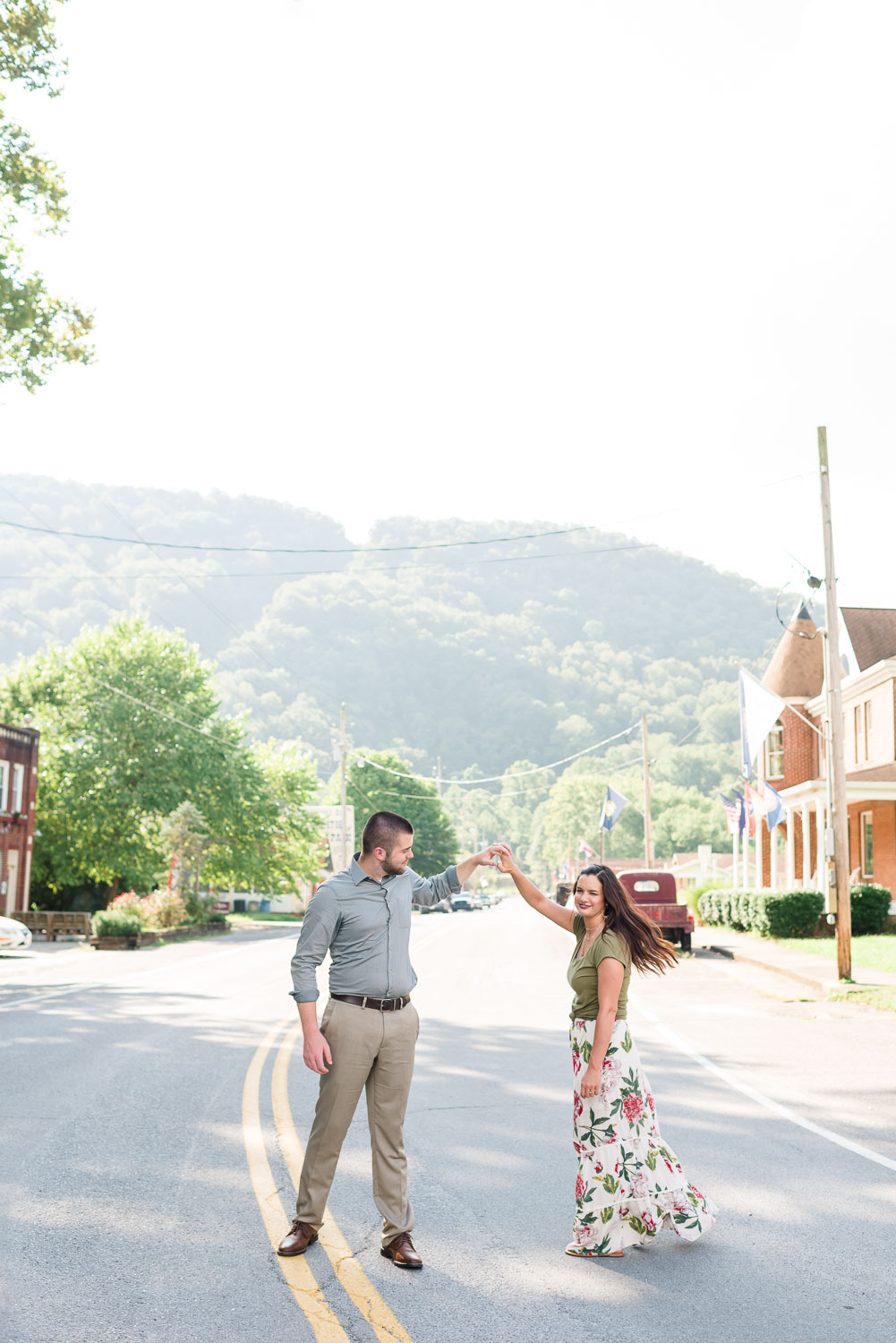 "two people ""dancing down Dixie Avenue"" in The town of Cumberland Gap on an August summer afternoon in front of the Whistler's antique shop"