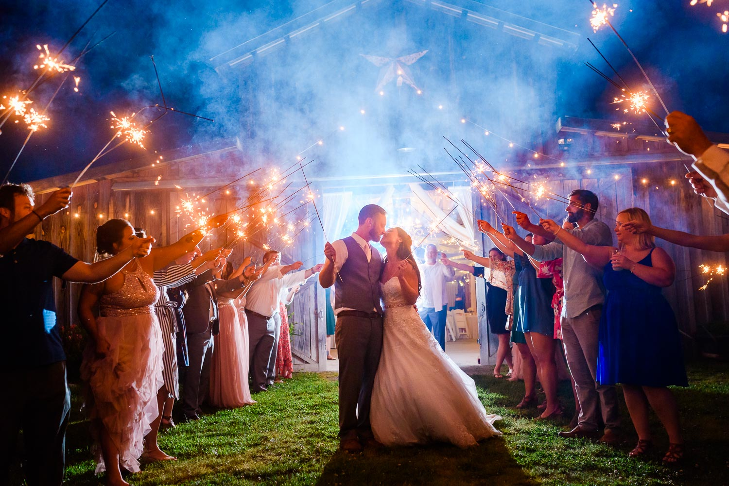wedding sparkler exit at night in front of the barn at Drewia Hill in early May