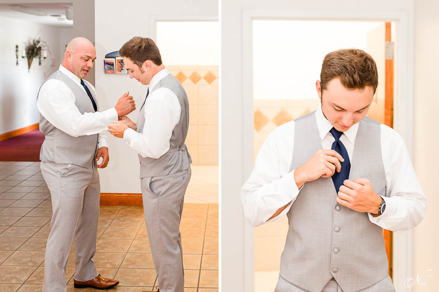 two guys in gray suits inside a church getting cuffs buttoned and ties straightened before the wedding.