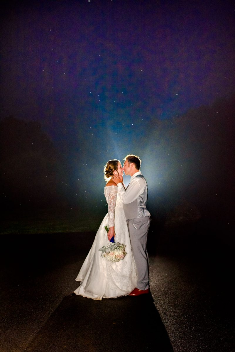 bride and groom standing in the fog at night in Gatlinburg TN