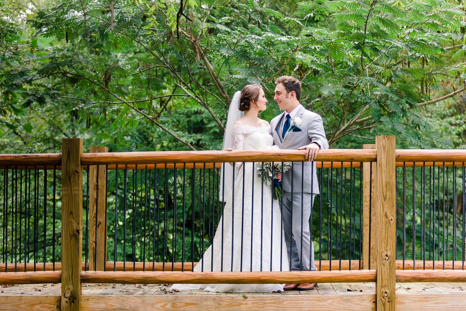 two people on a wooden walking bridge on their wedding day at 4 Points Farm in Gatlinburg TN