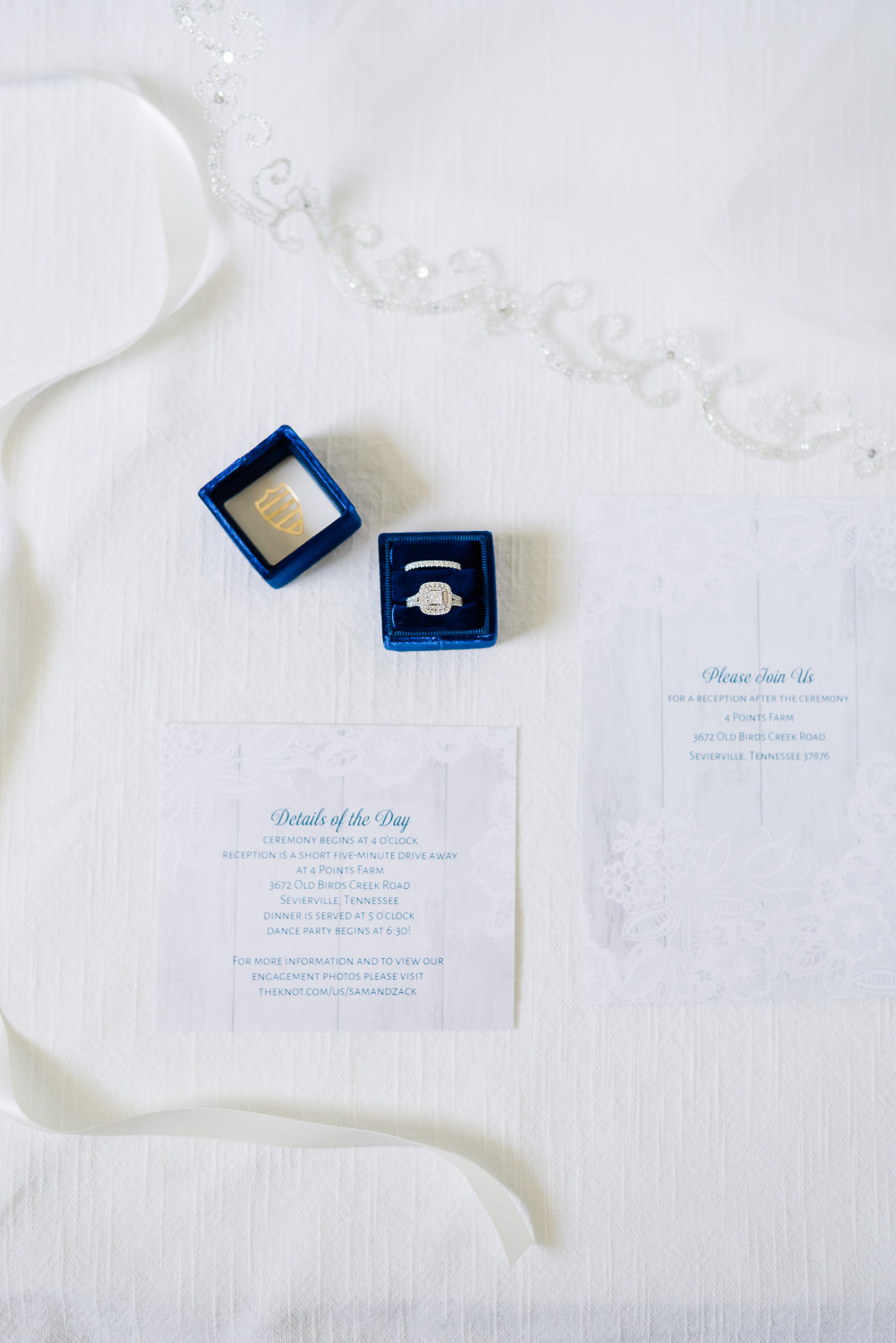 ROYAL BLUE MRS. RING BOX ANND NAVY AND WHITE INVITATION ON A WHITE BACKGROUND