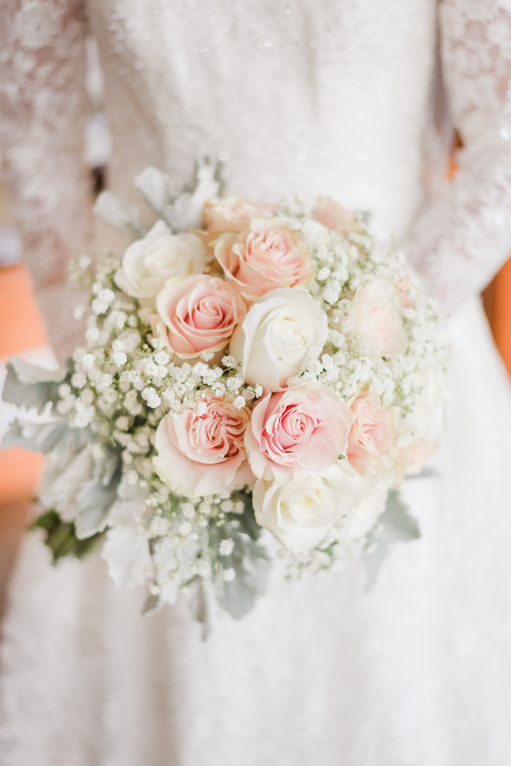 bride's wedding bouquet with pink and white roses, baby's breath and lamb's ear. In Sevierville TN