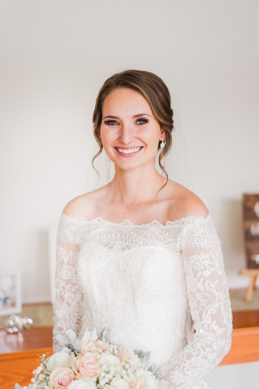 close up portrait of bride in off the shoulder wedding dress