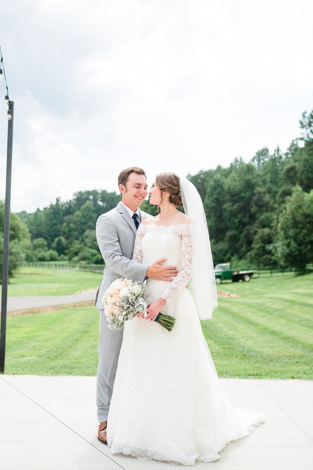 wedding day portraits of bride and groom on the front patio at four points Farm in Gatlinburg TN