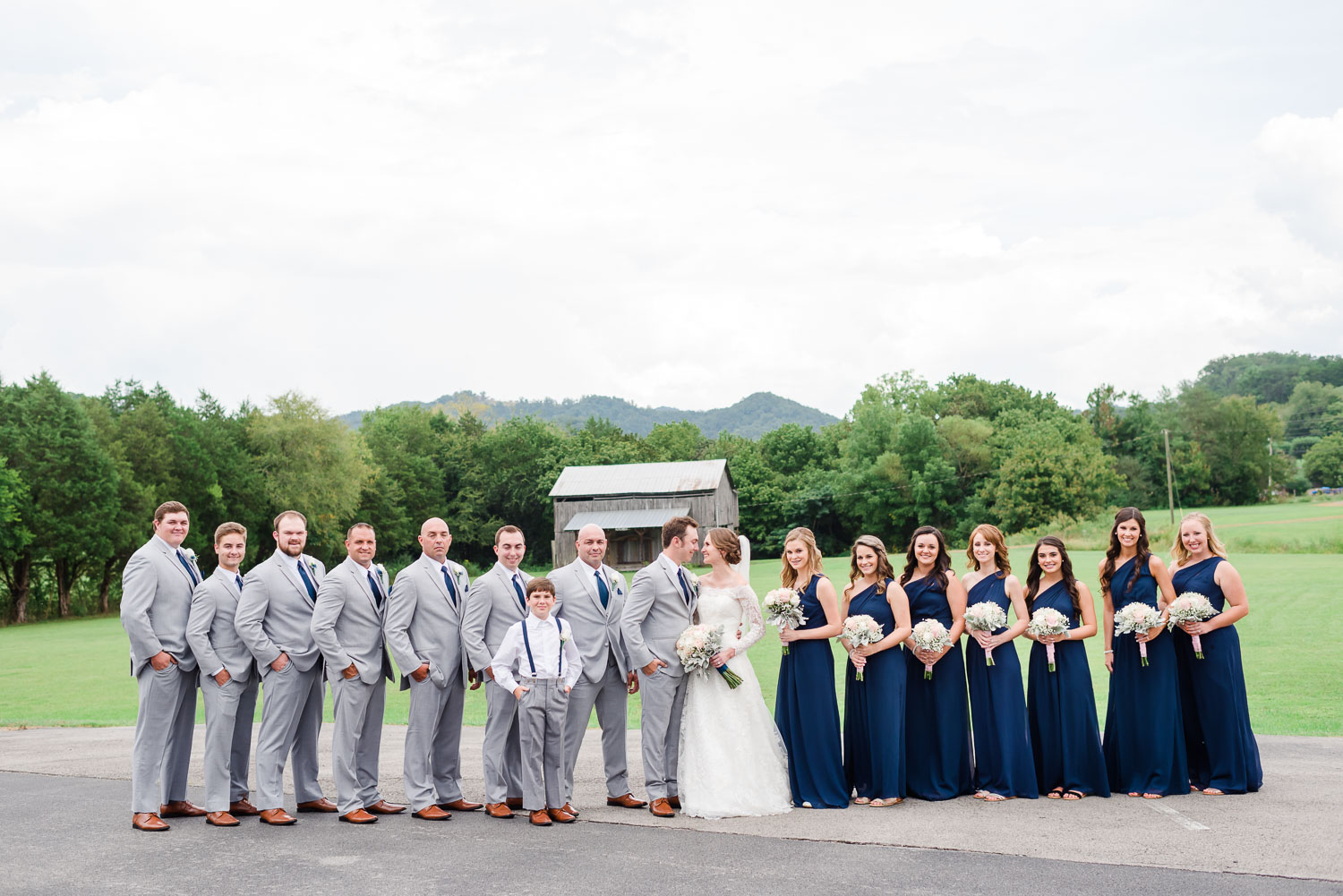 september wedding in Pigeon Forge TN with rustic barn in the background