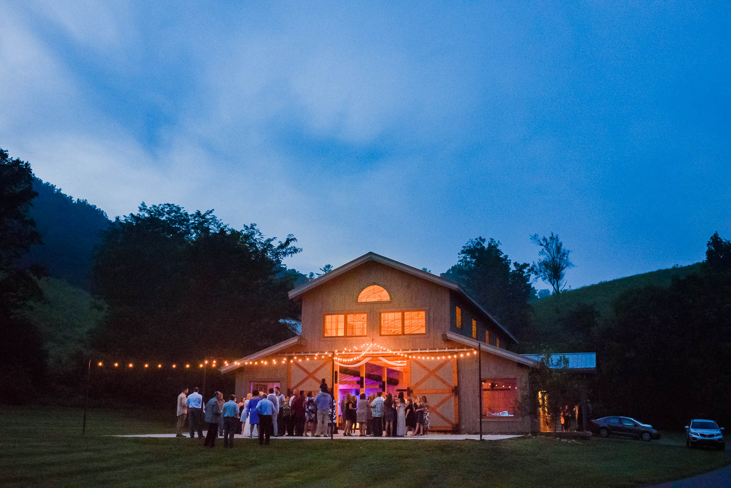 night time view of the venue at 4 Points Farm with a wedding reception in September.