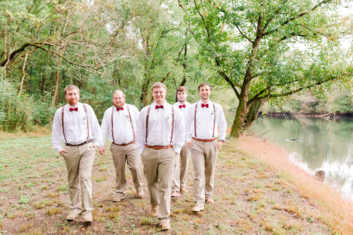 groomsmen walking outside on a rainy morning in Tennessee