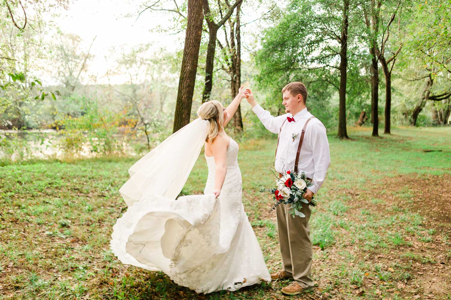 Bride and groom dancing under the riverside trees at Hiwassee River Weddings