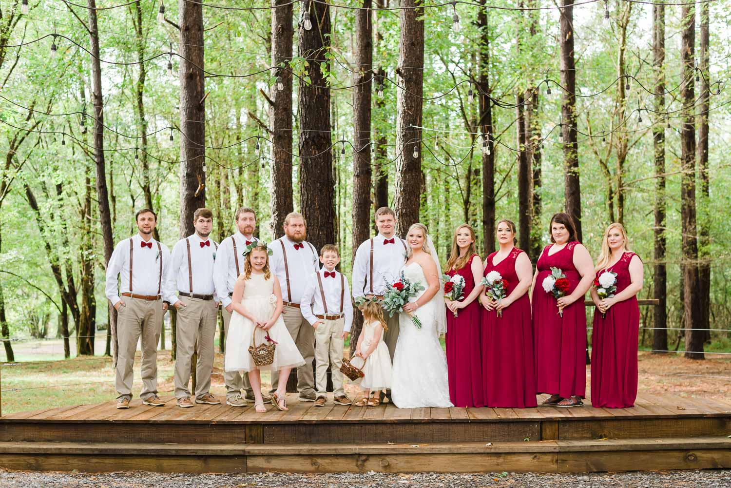 fall red and white wedding party at the Forest Ceremony site at Hiwassee River Weddings