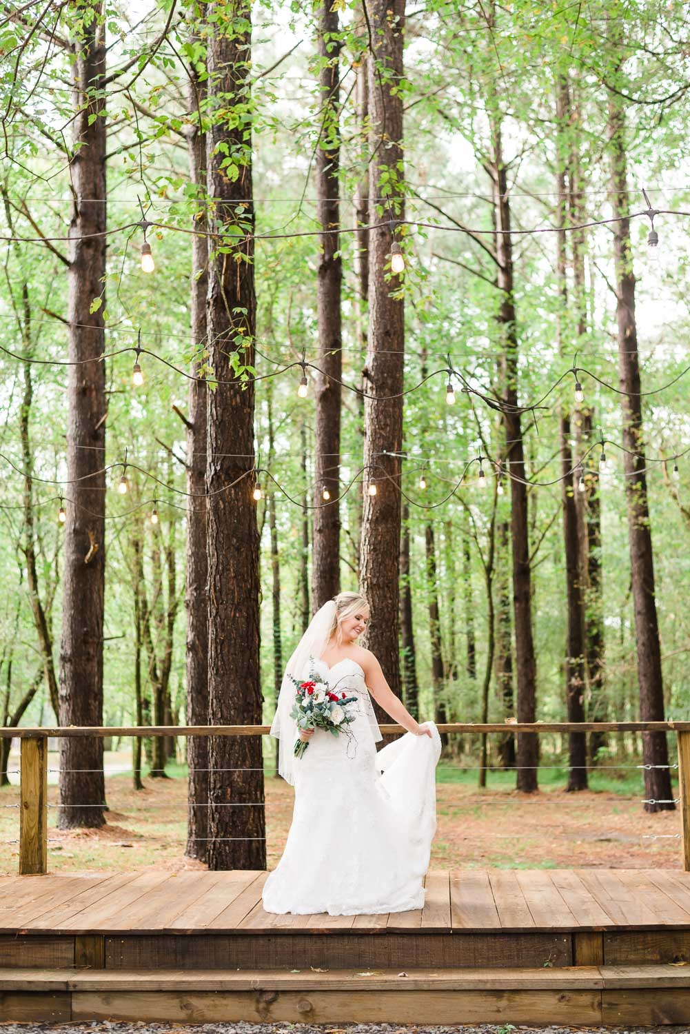 just the bride out dancing on the Forest Ceremony stage at Hiwassee River Weddings.