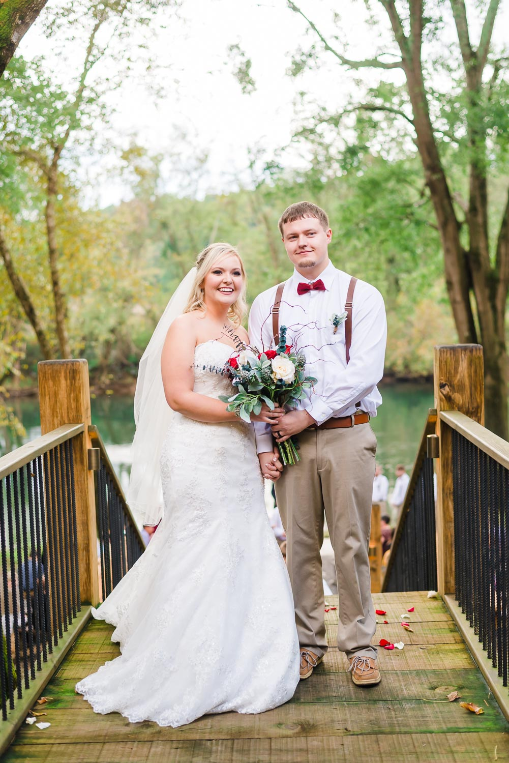 Wedding couple just married standing at the top of the stairs at Hiwassee River weddings between Knoxville And Chattanooga TN